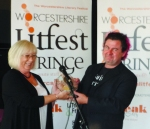 Maggie Doyle awards Fergus McGonigal with his Worcestershire Poet Laureate trophy